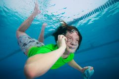Man speaking on the cell phone underwater Royalty Free Stock Photo
