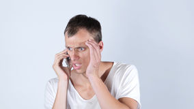 Man speaking on his cell phone ,jobless  sad, rejection of his work. High quality Royalty Free Stock Photo