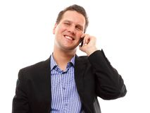 Man speaking on his mobile and smiling Stock Photography