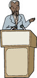 Man Speaking at Lectern Stock Image