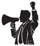 Man speaking in megaphone Stock Image