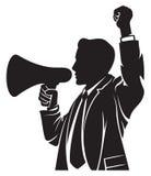 Man speaking in megaphone. Man speaks through the megaphone, man with a megaphone, businessman is using a megaphone Stock Image