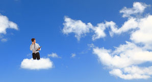 Man speaking mobile phone with cloud background Royalty Free Stock Photography