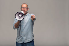 Man speaking over a megaphone Stock Images
