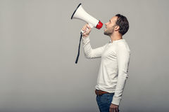 Man speaking over a megaphone Royalty Free Stock Image