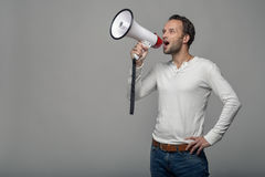 Man speaking over a megaphone Stock Image