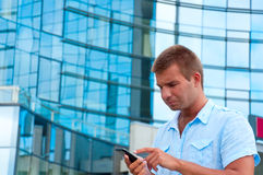 man speaking on phone in front of modern business building Royalty Free Stock Photography
