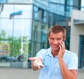 man speaking on phone in front of modern business building Royalty Free Stock Photo