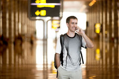 Man speaking on smartphone in airport Stock Photos