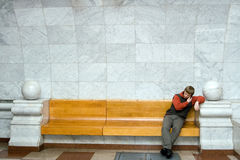 Man speaking on the telephone. And sitting at bench at Moscow subway Stock Photography