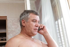 Man speaking by telephone Stock Image