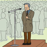 Man Speaking to Crowd. Mature man with microphone talking to audience Royalty Free Stock Images