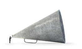 Man speaking through a vintage megaphone Stock Photography
