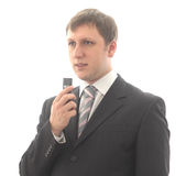 The man speaks in the digital recorder. Isolated object Stock Images