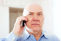 Man speaks by phone Stock Image