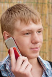 Man speaks by phone. Young man speaks by phone Stock Photo
