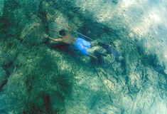 Man spearfishing with spear pole stock images