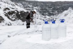 Man in special clothes collecting samples of water potentially contaminated by toxic material, in winter on the lake, in. Coal mine, expertise Stock Photos