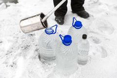 Man in special clothes collecting samples of water potentially contaminated by toxic material, in winter on the lake, in. Coal mine, expertise Royalty Free Stock Image