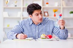 The man on special diet programm to lose weight. Man on special diet programm to lose weight Royalty Free Stock Image