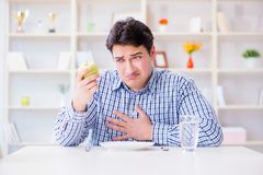 The man on special diet programm to lose weight. Man on special diet programm to lose weight Stock Photography