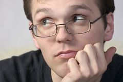 Man in spectacles. Thoughtful young man in spectacles Royalty Free Stock Images