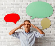 Man with speech bubbles Stock Photography
