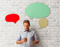 Man with speech bubbles Stock Image