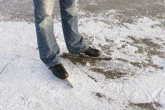 Man with speed ice skates on ice Royalty Free Stock Photo