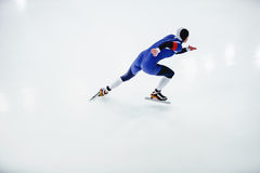Man speed skater in speed skating. Competitions on white background Royalty Free Stock Photo