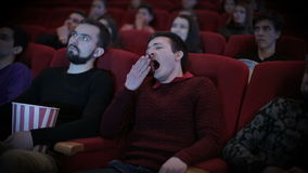 Man speening at cinema stock footage
