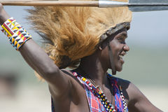 Maasai warrior, male lion mane on head, spear in hand, Tanzania Royalty Free Stock Image