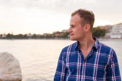 Man spending time on seashore in colorfull shirt. Stock Photos