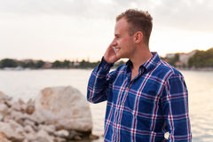 Man spending time on seashore and using phone. Stock Photo