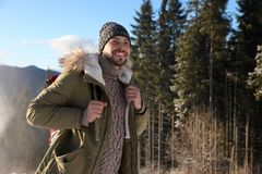 Man spending winter vacation in mountains. royalty free stock photos