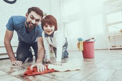 Father and Son Washing the Floor stock image
