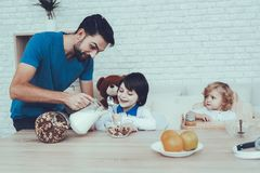 Father is Feeding His Sons a Breakfast royalty free stock image
