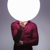 Man with sphere of light as head is thinking Stock Photo