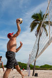 Man Spikes Ball In Pickup Miami Beach Volleyball Game. Miami, FL, USA - December 27, 2014:  A man jumps to spike the ball in a pickup game of beach volleyball on Stock Photography