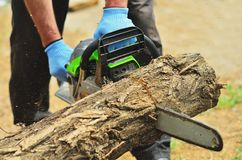 In the frame man spills a log chainsaw stock images