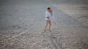 Man spinning around his woman.On the beach. stock video footage