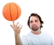 Man spinning a basketball Stock Photography
