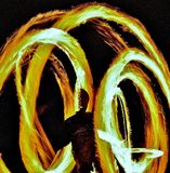Man Spinning Fire. Night shot of a man in full fire spin , one second shutter caught this stock photo