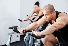 Man spinning veloargometer gym Stock Photos
