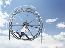 Man in spinning wheel Stock Images