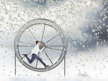 Man in spinning wheel Royalty Free Stock Photos