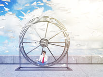 Man in spinning wheel Royalty Free Stock Image