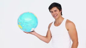 Man spins a globe in his hand stock footage