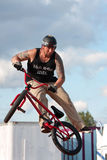 Man Spins His Bike In MidAir Performing At BMX Show. Hampton, GA, USA - September 27, 2014:  A young man with the High Roller BMX club spins his bike in midair Stock Photography
