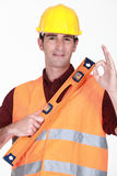 Man with spirit-level Stock Photos
